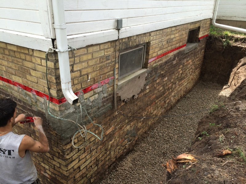 Brick Foundation Prep for waterproofing